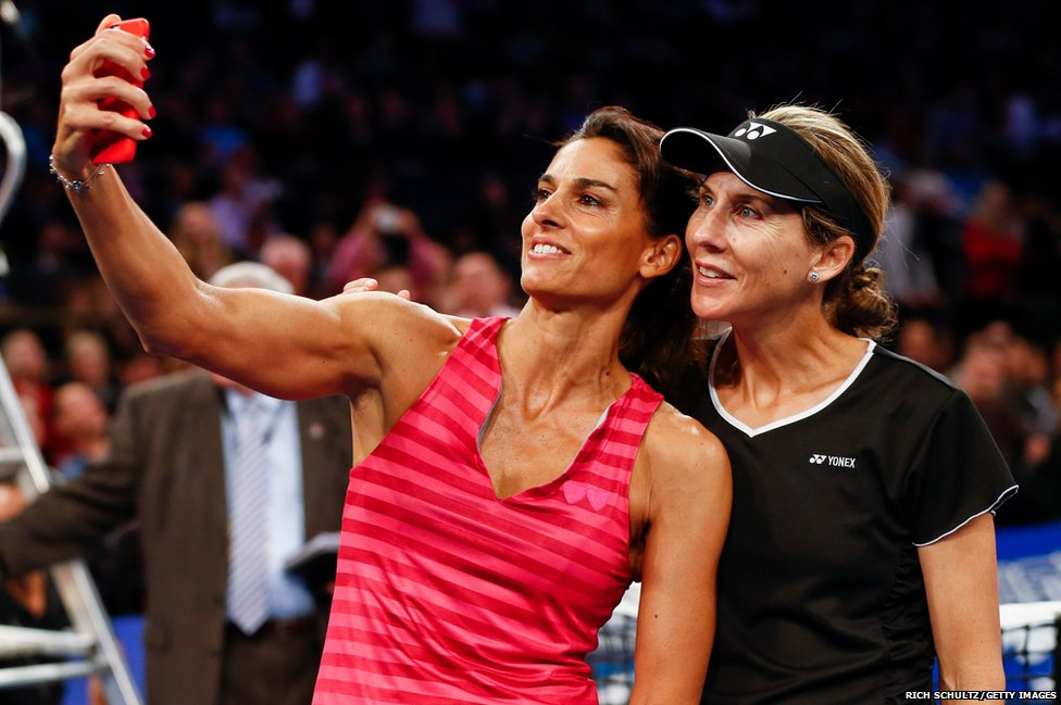 Tennis players Gabriela Sabatini of Argentina and Monica Seles of the United States pose for a selfie