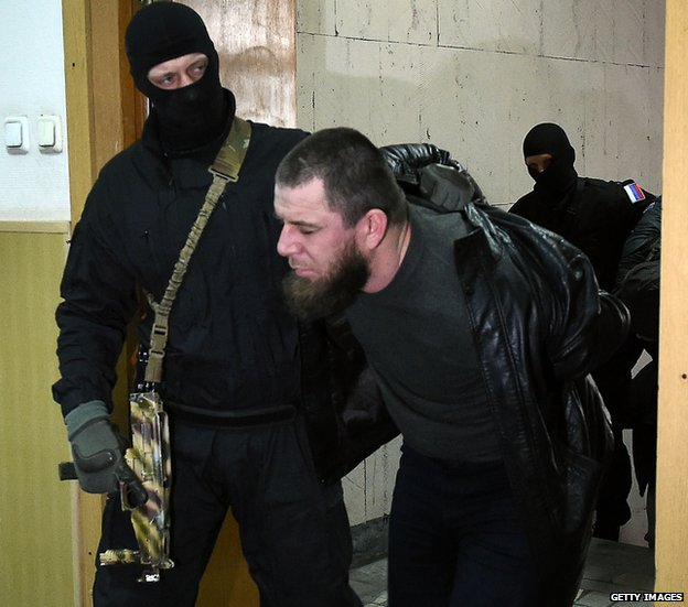 Tamerlan Eskerkhanov being led into court